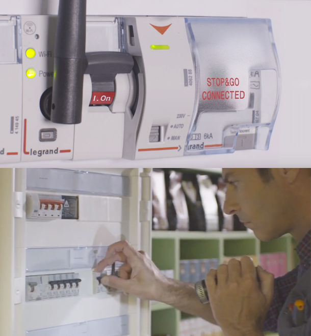 Image of the STOP & GO and an electrician working on it